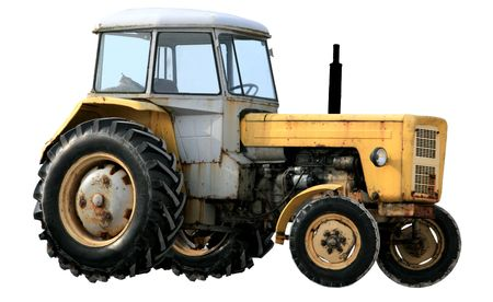 Yellow tractor isolated on white background photo