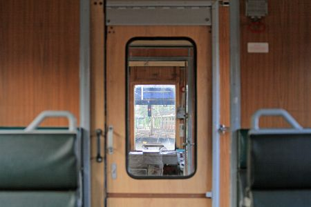 compartment: View from the passenger compartment towards front of the train