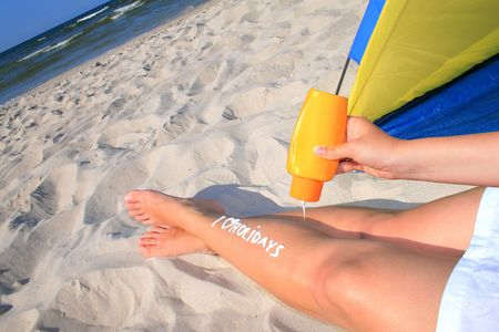 Woman with creamy sign I love holidays on her legs Stock Photo - 5544037