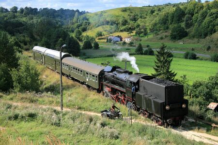Beautiful hilly landscape with an old retro steam train Stock Photo - 5585150