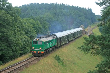 Passenger train passing through polish countryside
