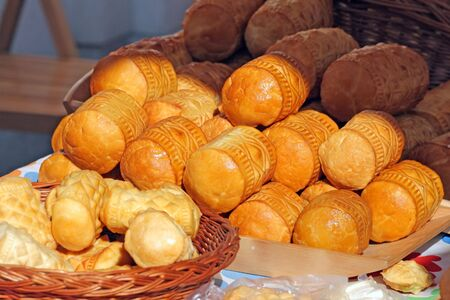 Traditional Polish smoked cheese known as oscypek at the market