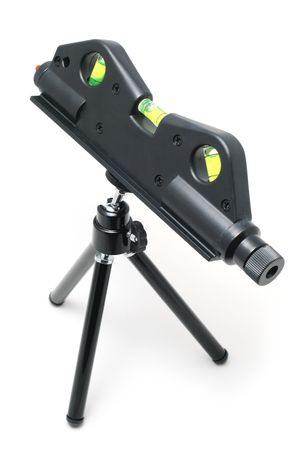 Laser level tool on a tiny tripod isolated on white background Stock fotó
