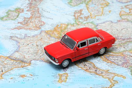 Tiny red car model on the map of Europe Stock Photo