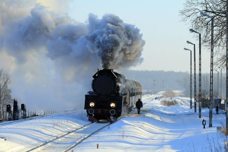 Vintage steam train stopped at the station, wintertime