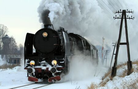 old train: Vintage steam train passing through snowy countryside
