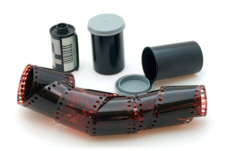35 mm negative film and canisters isolated in white background