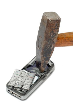 Hammer smashing cellular phone isolated on the white background