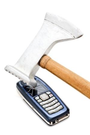 Meat tenderizer smashing cellular phone isolated on the white background photo
