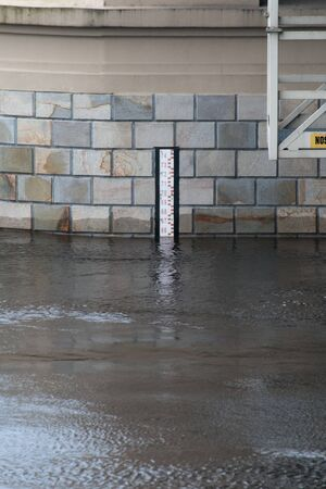 depth measurement: Black and white water level gauge on the bridge during the flood Stock Photo