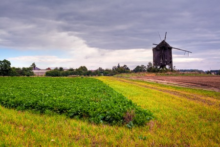 Landscape with the old wooden windmill