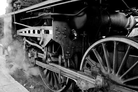 Close up of the wheels and suspension of the old steam engine photo