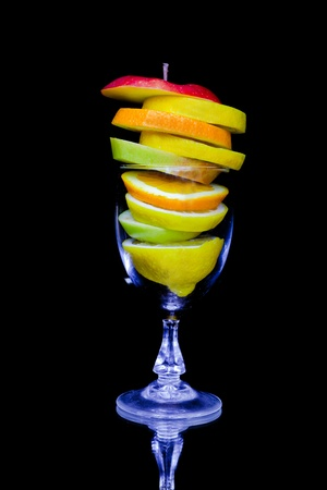 Fruit cocktail composition isolated on black background photo
