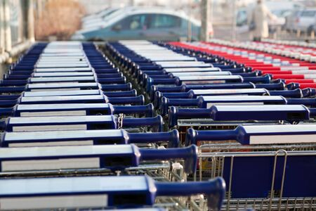 Row of empty shopping carts at the supermarket