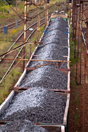 Coal train passing through the station Stock Photo - 11167313