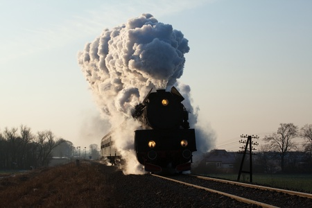 Vintage steam train starting from the station, wintertime