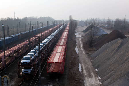 aggregates: Freight trains with different cargo on the station Stock Photo
