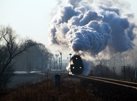 loco: Vintage steam train starting from the station, wintertime
