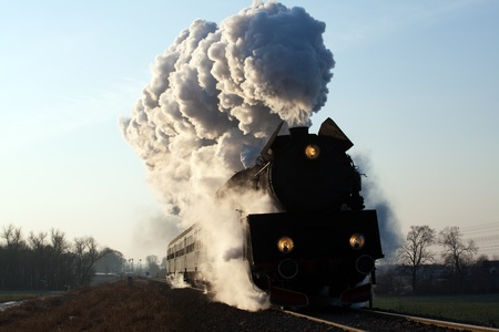 Vintage steam train starting from the station, wintertime Stock Photo - 12813153