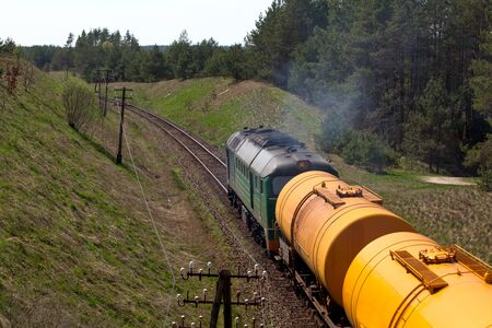 Freight train passing the countryside Stock Photo - 13563975