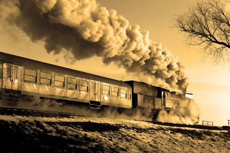 loco: Vintage steam train puffing through countryside during wintertime
