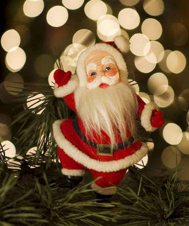 Vintage Santa by Christmas tree