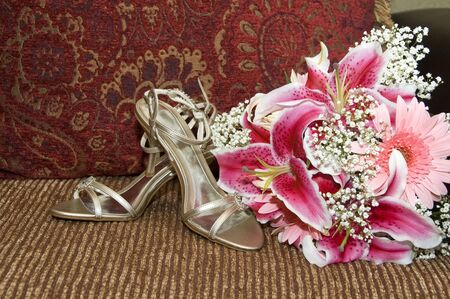 Wedding details of a brides shoes and bouquet