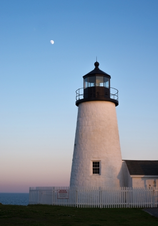 Moonrise by lighthouse