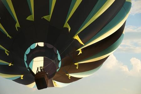 Hot air balloon against a cloud filled sky Stock Photo