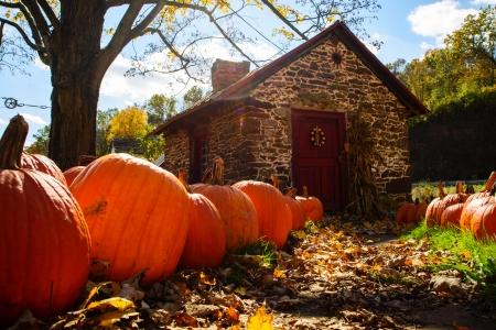 Little stone house in autumn Stock Photo
