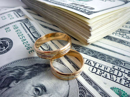 Gold wedding rings on the money photo