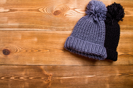 knitten: Winter hats with pompom Stock Photo