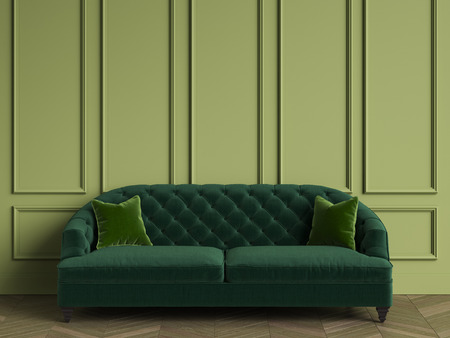 Classic Tufted Sofa In Emerald Green Color In Classic Interior With Copy  Space.Green Walls