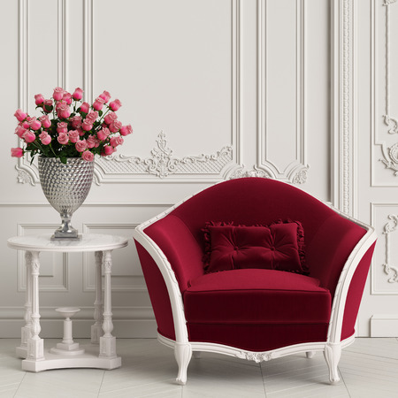 Classic carved armchair with arved details upholstered in red velvet in classic interior. Big vase with red roses on the classic table.Digital Illustration.3d rendering Stock Photo
