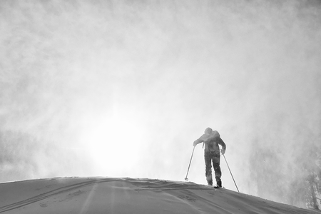 Ski touring in harsh winter conditions Stock Photo