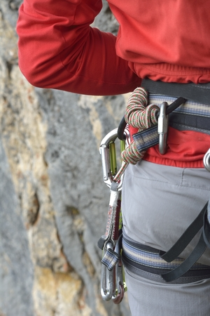 Climbing harness with climbing equipment