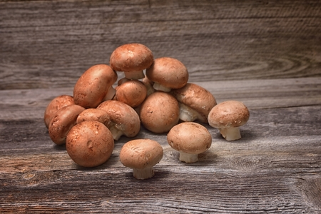 Brown champignon mushrooms on the table Stok Fotoğraf