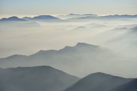 generic location: Fog in the valley in the morning Stock Photo