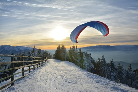 Paragliding in winter mountains Stock Photo