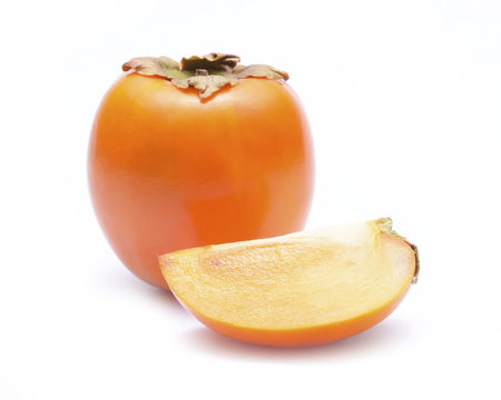 Organic persimmon fruit - isolated on a white background Stock Photo