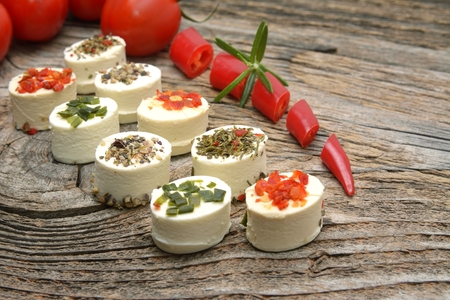 ittle: Feta cheese appetizer with spices on wooden table