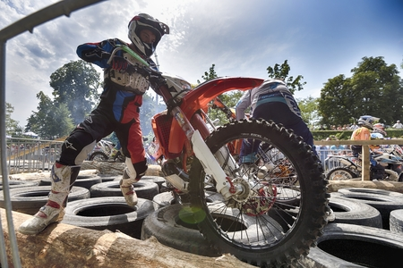 SIBIU, ROMANIA - JULY 25: Unknown competitor in Red Bull ROMANIACS Hard Enduro Rally with a KTM motorcycle. The hardest enduro rally in the world. July 25-29, 2017 in Sibiu, Romania. The prologue stage Editorial