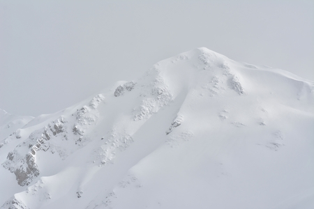 Mountain peak covered with snow Imagens