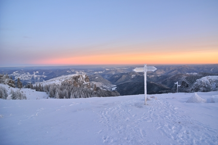 Sunrise above the mountain peaks, view from Ceahlau mountains, Romania.