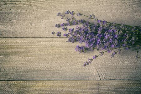 Lavender flower bouquet on wood background.