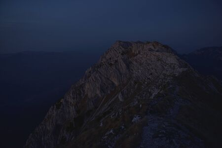 Blue hour over the mountain ridge. Mystic mountain early morning landscape.