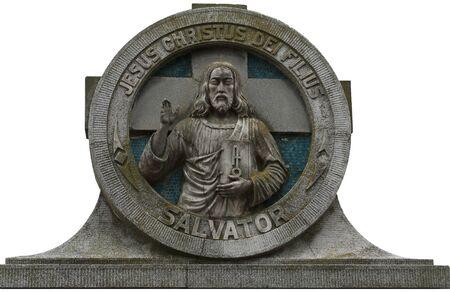 christus: Old tombstone with figure and the inscription Jesus Christus Dei Filius  Salvator Stock Photo