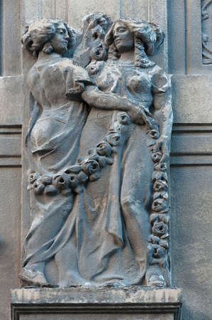parget: Woman statue on the wall. Architecture detail. Stone sculpture. Parged with plaster