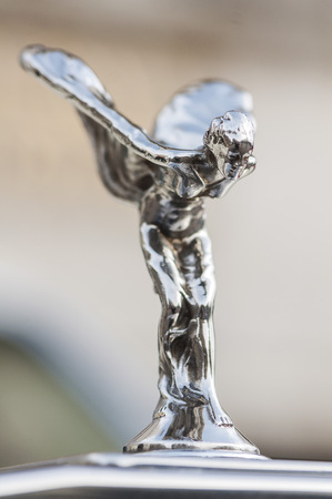 Close-up on Spirit of Ecstasy on a Rolls Royce.