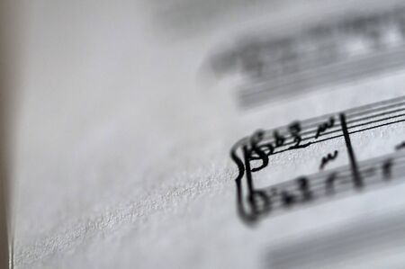 musical score: Detail of a music sheet score page. Shallow depth of field. Stock Photo